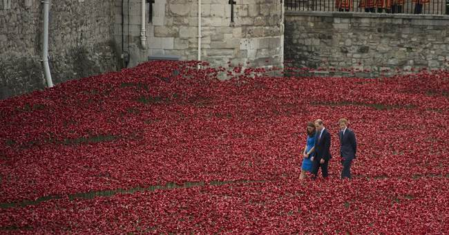 Red ceramic poppies spill from Tower of London