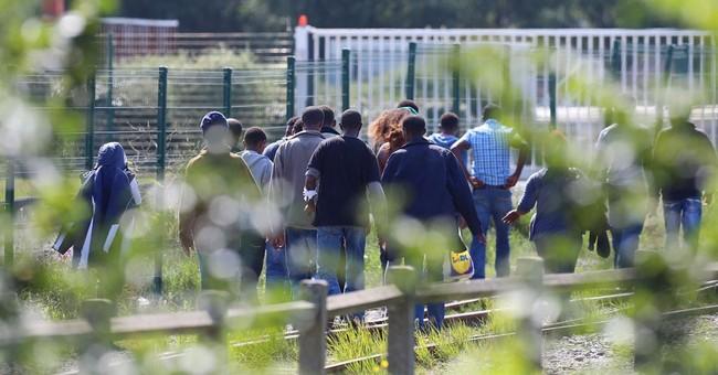 Migrants clash in France as camp tensions soar
