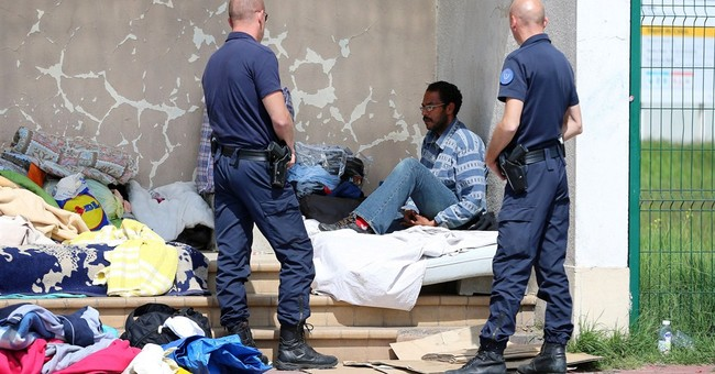 Migrants clash in France as camp tensions soar