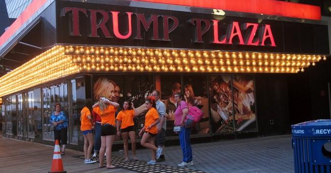 APNewsBreak: Trump sues to get name off casinos