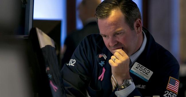Asian stocks mostly down on Ukraine, Iraq jitters
