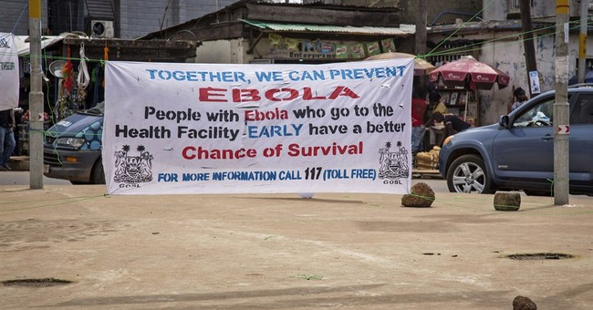 Britain pledges new funding to contain Ebola