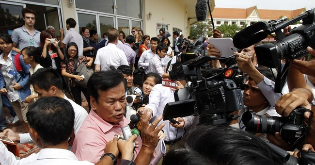 Miles away and years on, Cambodians relish verdict