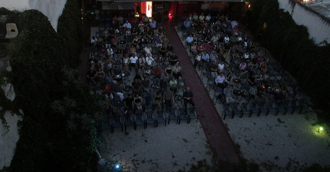 AP PHOTOS: Outdoor cinemas fade to black in Greece