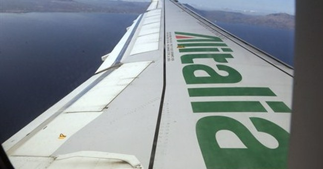 Etihad buys 49 percent of loss-making Alitalia