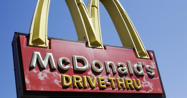 McDonald's sales hit by China scandal, US weakness
