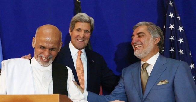 Afghan candidates agree to resolve dispute