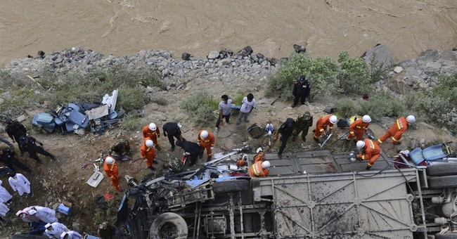 Tibet tour bus plummets into valley, killing 44