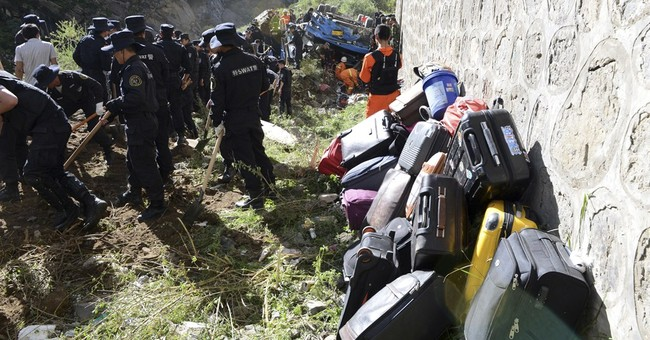 Tibet tour bus plummets into valley, killing 44