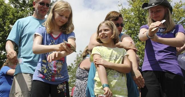 Ohio park says it set record on applying sunscreen