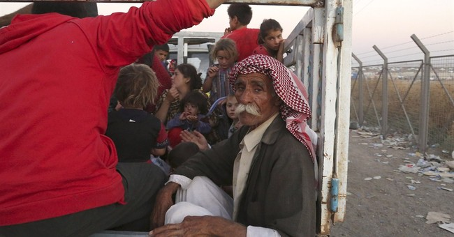 Thousands from Iraq minority flee to Syria