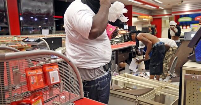 Vandalism, looting after vigil for Missouri man