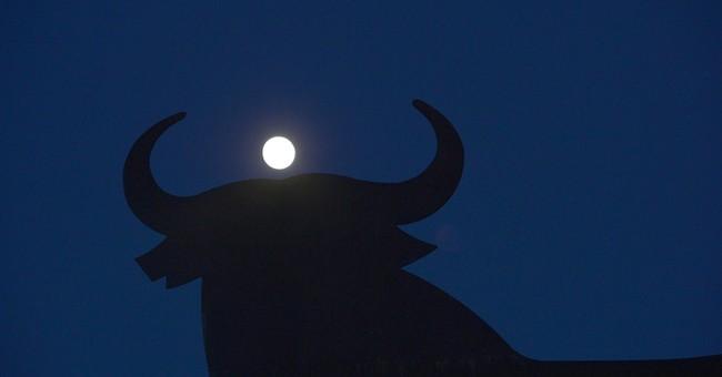 AP PHOTOS: Lunar show illuminates world's skies