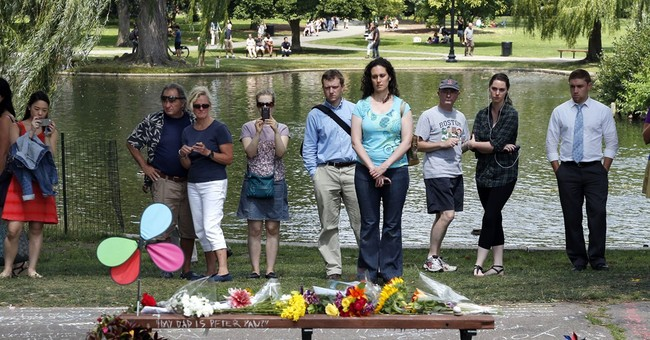 Fans leave Williams tributes at Boston park bench
