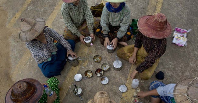 AP PHOTOS: Planting rice traditionally in Myanmar