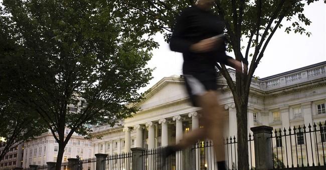 US budget deficit running 24.2 percent below 2013