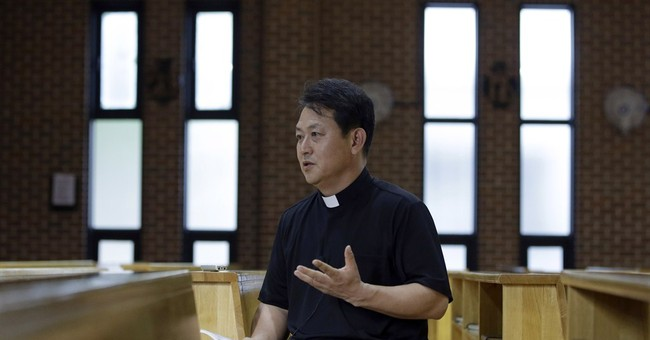 Korean martyrs' descendants feel pride and burden