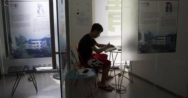 Chinese seek freedom, edge at US high schools