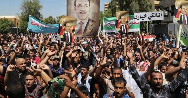 Iraq's al-Maliki gives up post to rival
