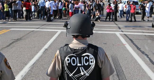 Police use tear gas on Ferguson protesters