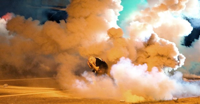 Police images fuel outrage in St. Louis and beyond