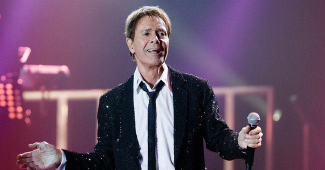 UK police search singer Cliff Richard's house