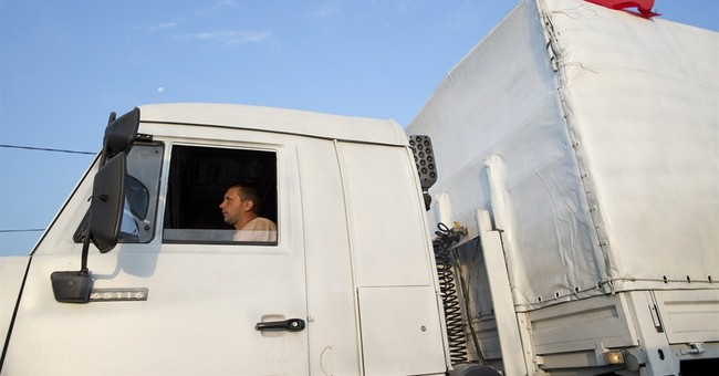 Ukraine, Russia parry over Russian aid convoy
