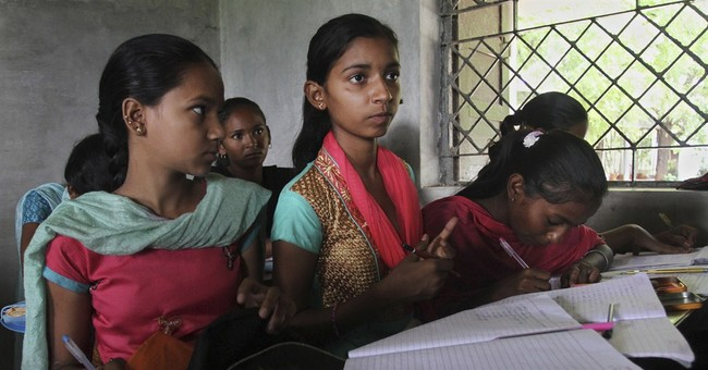 AP PHOTOS: Swimming to school in western India