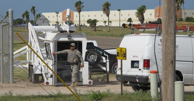 Correction: Immigration-National Guard story