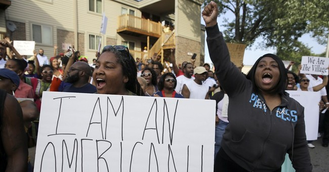Protesters gather in Ferguson, carry signs, chant