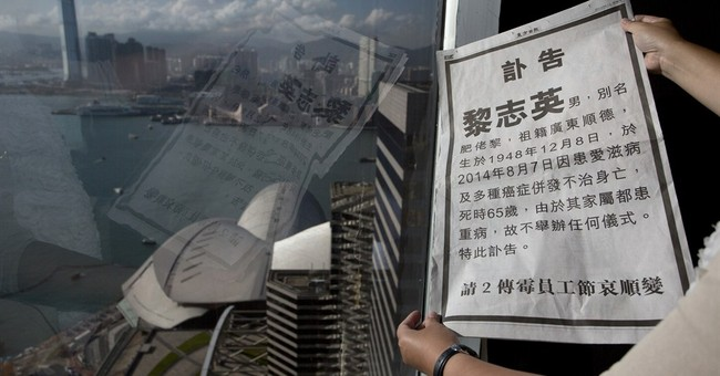 HK news boss counters rival's fake obit with video