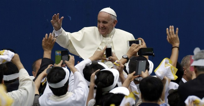 Papal visit underscores religious divide in Koreas