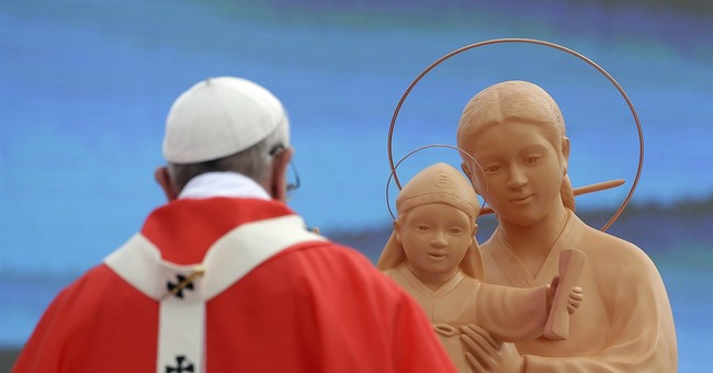 Huge crowds greet pope at martyr beatification
