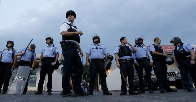 Police deploy tear gas to  impose Ferguson curfew
