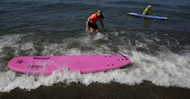 Camps take cystic fibrosis patients surfing