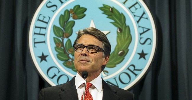 Texas Gov. Perry defends veto that led to charges