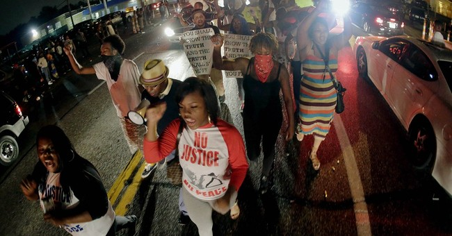 Police shooting draws protesters from near, far