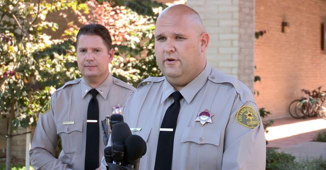 Teen arrested in online school-shooting threat