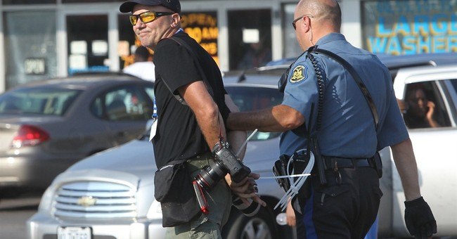 Ferguson arrests include at least 10 journalists