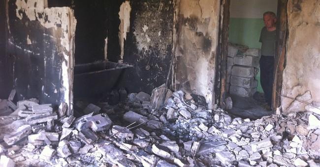 Grief, relief as ravaged Ukrainian town rebuilds