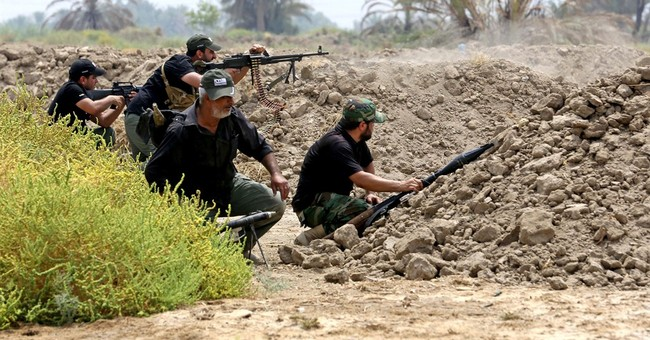 Iraqis in besieged town appeal to army for help