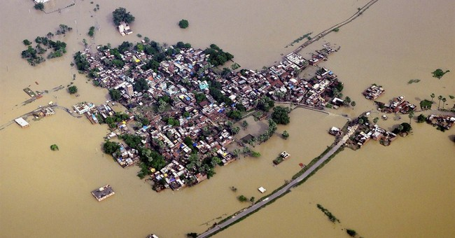 180 dead as floods wash away homes in Nepal, India