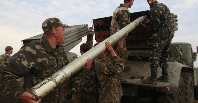 Ukrainian forces press attacks on rebel-held areas