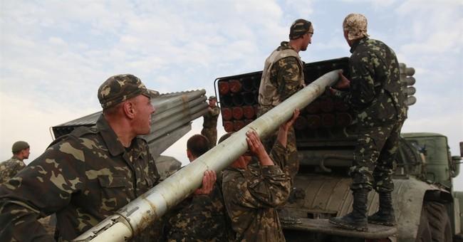 Ukrainian forces press attacks on rebel-held areas
