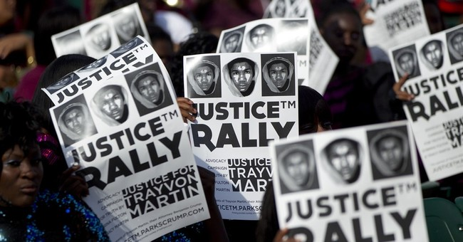 Holder brings his civil rights push to Ferguson