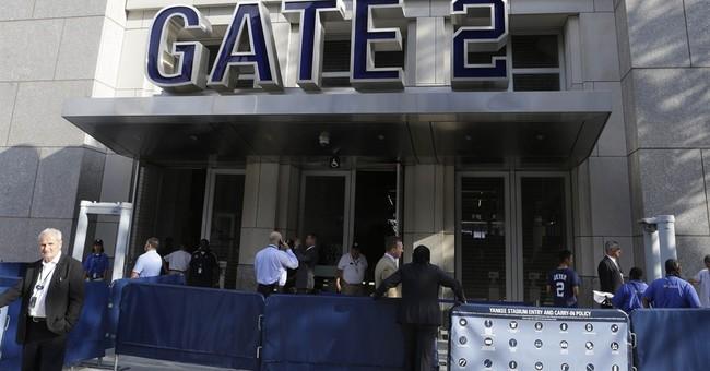 Fans go through metal detectors at Yankee Stadium