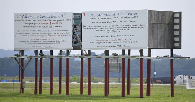 Brine firm sues over biblical fracking billboard