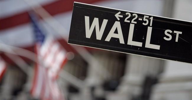 Despite Fed, a late push sends US stocks higher