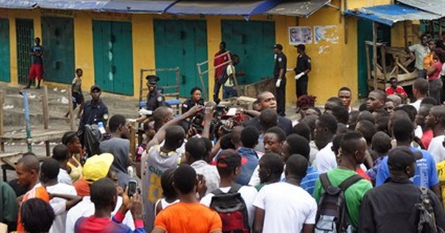 Liberian slums barricaded as Ebola sets new record