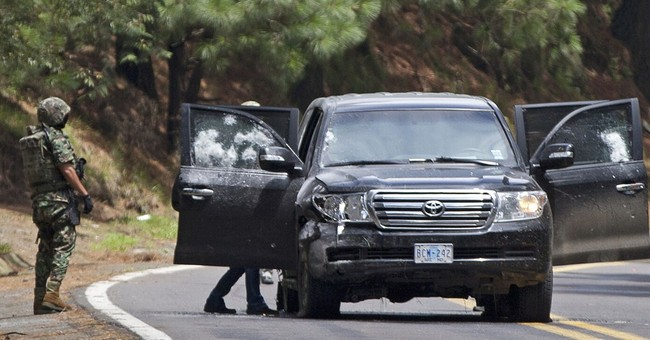 Mexico: 14 police on trial for US  SUV shooting